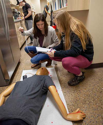Students at a crime scene