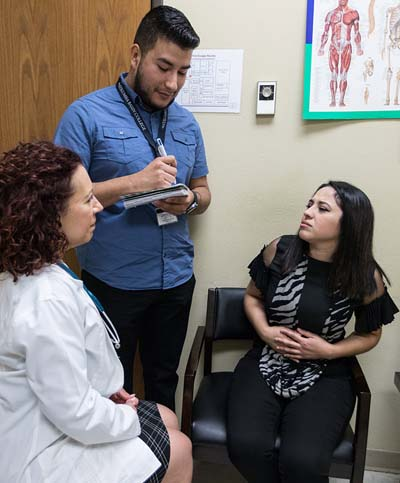 image of interpreter with doctor and patient